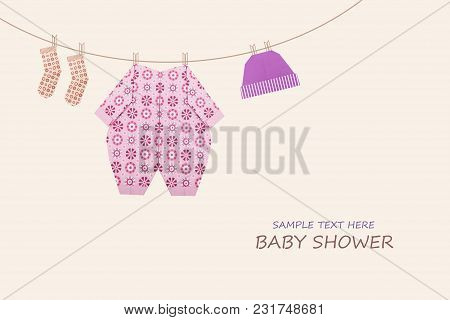Baby Girl Clothing On Clothesline On Yellow Background