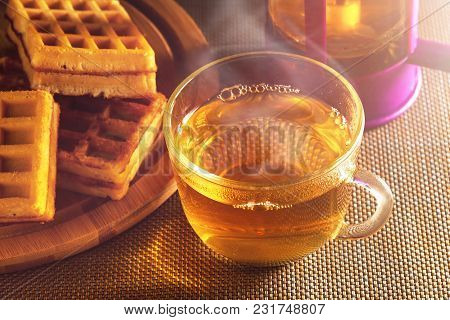 Homemade Waffles With Jam On Old Wooden Table. Wafers With Cup Of Tea With Teapot