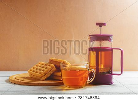 Homemade Waffles With Jam On Old Wooden Table. Wafers With Cup Of Tea With Teapot. Copy Space