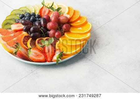 Variety Of Fruits And Berries In Rainbow Colours Platter Close Up, Strawberries, Grapes, Blueberries