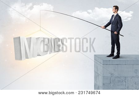 Young businessman fishing money, income from the top of a building