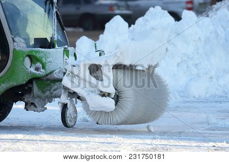 Street Cleaning The City From Snow With The Help Of Special Equipment Mini