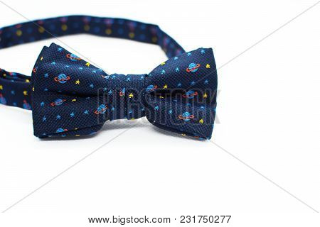 Beautiful Colorful Blue Bow Tie With Light Blue Planets And Yellow Stars On White Background With Sp
