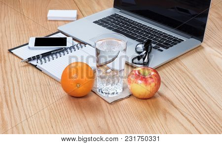 Healthy Food And Water With Clean Working Wooden Desktop
