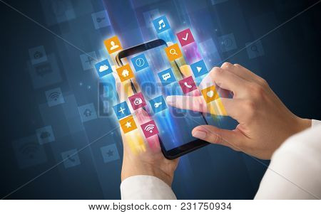Female hand using smartphone with colorful angular fast switching application icons around