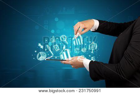 Elegant hand holding tablet with chalk drawn social media symbols above
