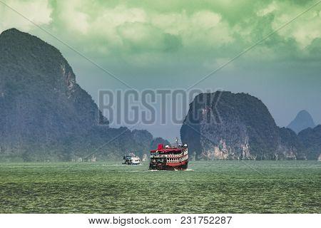 Sightseeing Boats Sailing Between The Calcareous Islands Of Phang Nga Bay Thailand