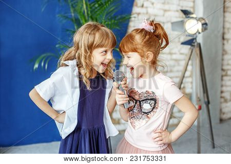 Two Happy Little Children Sing A Song In Karaoke. The Concept Is Childhood, Lifestyle, Music, Singin