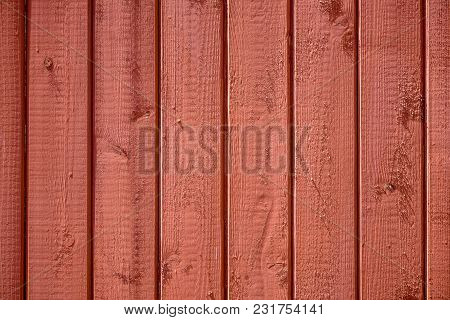 Fence Of Vertical, Tightly Fitted Painted Boards With Wood Structure