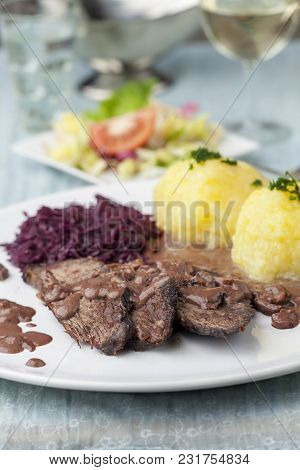 German Sauerbraten With Red Cabbage On A Plate