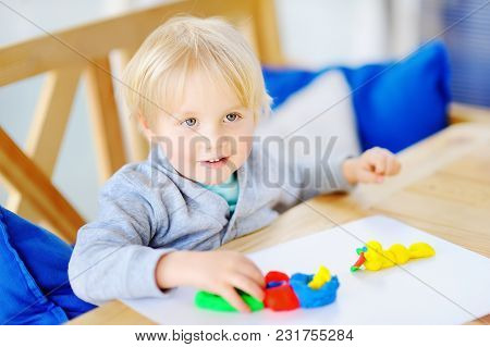 Creative Boy Playing With Colorful Modeling Clay At Kindergarten. Little Kid Molding At Home. Develo