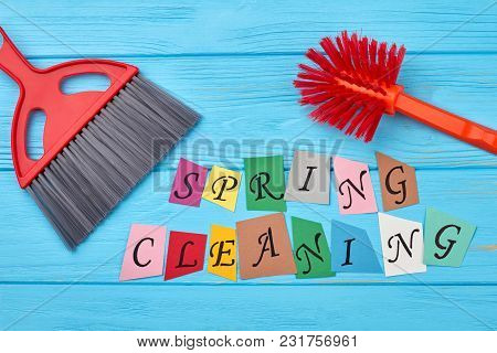 Brushes For House Cleaning On Wooden Background. House Cleaning Set On Wooden Background. Cut Out Pa