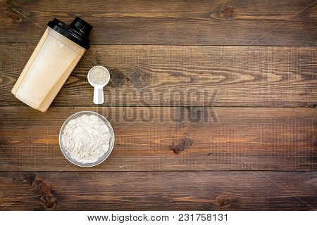 Protein Powder For Fitness Nutrition To Start Training On Wooden Desk Background Top View Mock-up