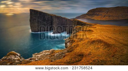 Panorama Of Sorvagsvatn Lake And Cliffs Of Traelanipa On Vagar Island In Sunset, Faroe Islands