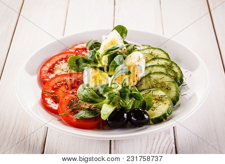 Boiled eggs and vegetables
