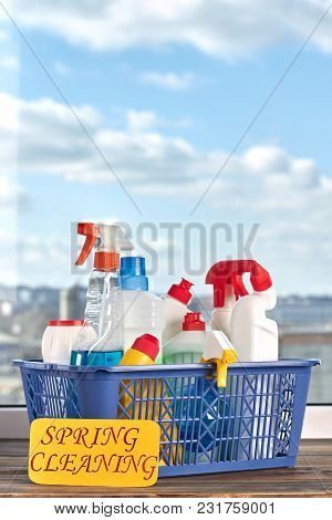 Cleaning Supplies Kit In Basket. House Cleaning Products On Blue Sky Background. Professional Cleani