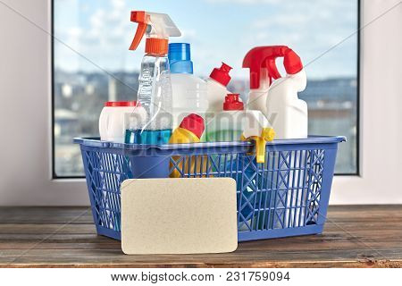 Set For Spring Cleaning In Basket. Spring Cleaning Concept With Supplies On Wooden Background.