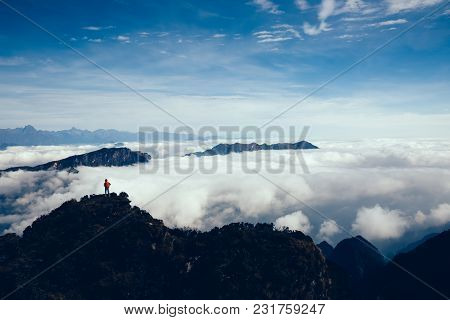 Hiker Hiking In Beautiful High Altitude Mountains