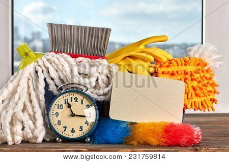 House Cleaning Items And Alarm Clock. House Cleaning Materials And Alarm Clock. Time For Big Cleanin