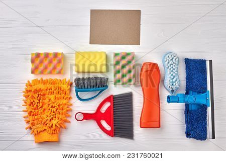 Multiple House Cleaning Products. Brushes And Sponges For House Cleaning On White Wooden Background.