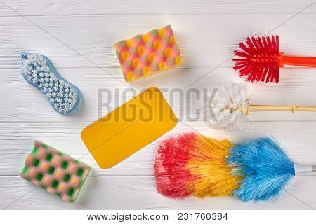 Equipment For Cleaning, Top View. Set Of Products For Cleaning On Wooden Background. Paper Card For
