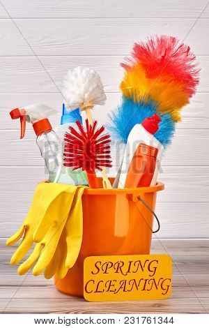 Spring Cleaning Wooden Background. Assortment Of Cleaning Brushes And Liquid In Bucket. Spring Clean