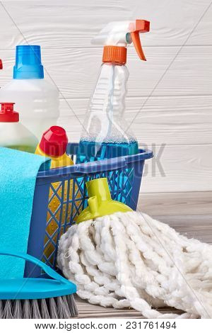 Set Of Detergents In Plastic Basket. Mop And Brush For Cleaning On The Floor. Equipment For House Wo