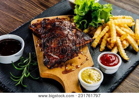 Grilled ribs with Franch fries and vegetables