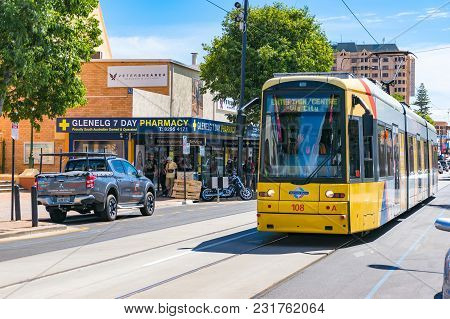 Glenelg, Australia - November 13, 2017: Bright Yellow Tramway With Friendly Driver Waving His Hand.