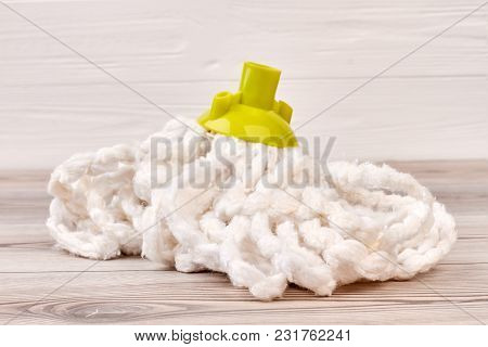 Mop For Cleaning Floor, Wooden Background. Close Up Microfiber Equipment For Washing Floor. House Cl