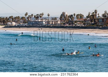 San Diego, California/usa - February 3, 2018:  Surfers Near The Shoreline Wait To Catch A Wave At Oc