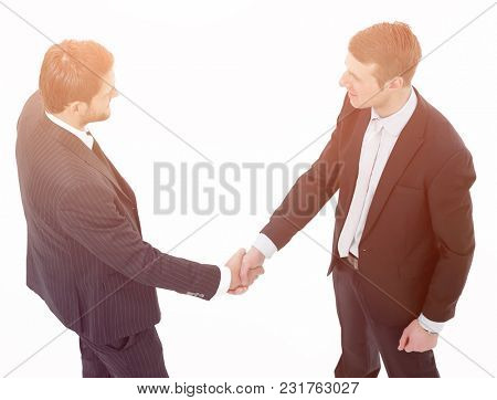 in full growth.handshake, business partners ,isolated on white background.