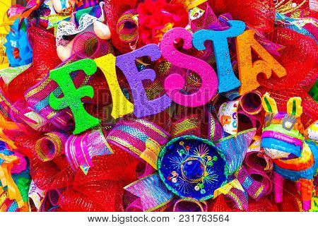 The Word 'fiesta' Written In Colorful Foam Letters On Multicolored Mash Decorated With Glitter And S