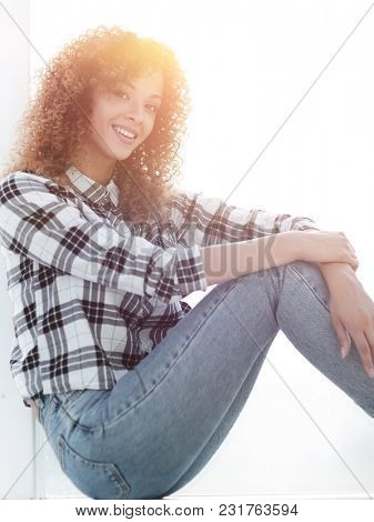 cute young woman in a plaid shirt and jeans.