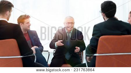 senior businessman holds a meeting with the business team
