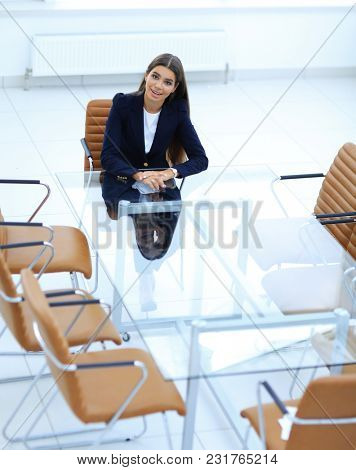 woman Manager is sitting at the table