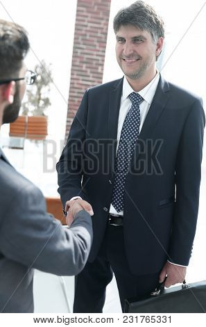 Handshake of a businessman and a lawyer in the office