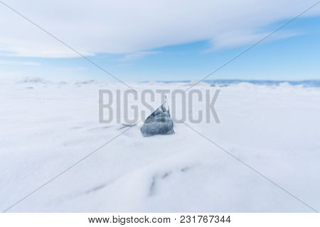 Ice Melting On Snow. Climate Change And Global Warming Concept