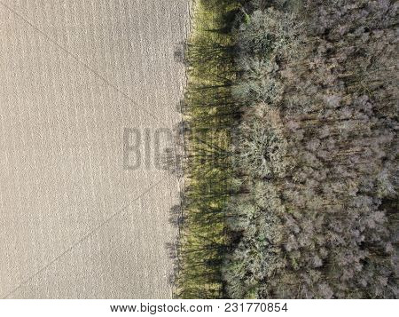 Aerial photo field woodland forest edge perimeter earth silt soil winter rural countryside
