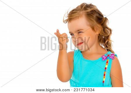 Little Girl Is Showing A Finger