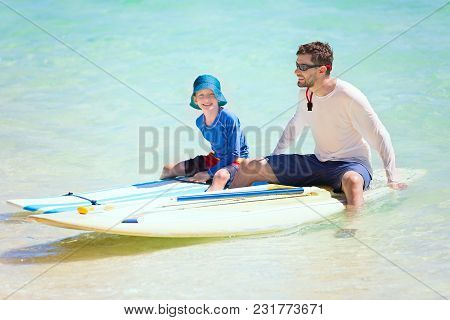 Happy Family Of Two, Father And His Son, Enjoying Active Vacation At Fiji Island Resting After Stand