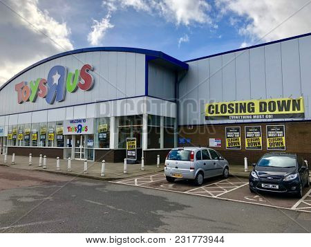 LONDON - MARCH 16, 2018: Closing down price reduction banners at Toys R Us following the liquidation of the company in Brent Cross, North London, UK.