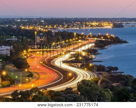 Evening Traffic Along The Kwinana Freeway Next To The Swan River In Perth, Western Australia.