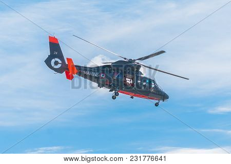 Fecamp-france, September 16,2017 - Non Foucus Scene Display Coast Guard Of Helicopter In Flight Read