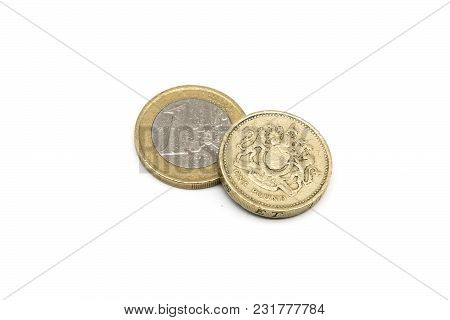 One Euro And Old One Pound Coins Isolated On White Background