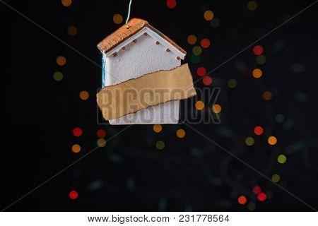 Little Model House On A Bokeh Light Background