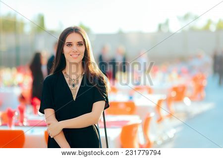 Beautiful Woman In All Black Outfit Attending Outdoor Party
