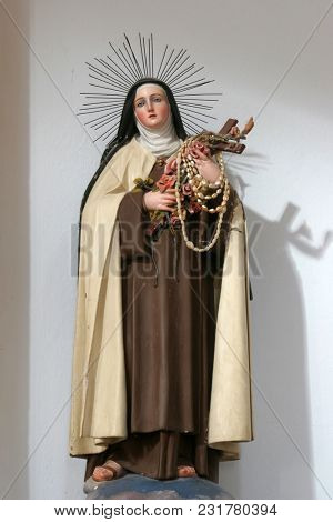 SMOKVICA, CROATIA - MARCH 21: Saint Teresa, statue on the altar in the Church of Blessed Virgin of Purification in Smokvica, Korcula island, Croatia, on March 21, 2017.