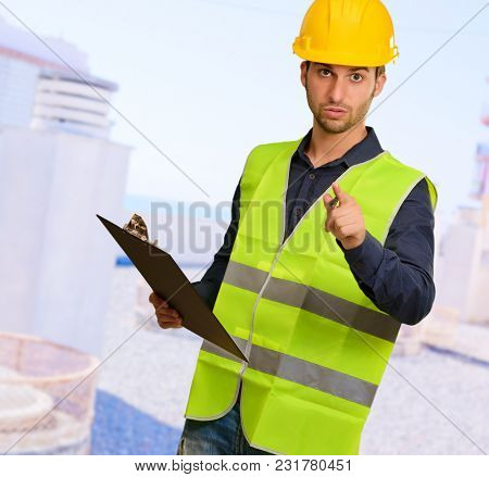 Young Engineer Holding Writing Pad Gesturing, Outdoors