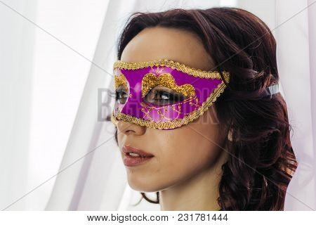 Beautiful Young Woman In Pink And Golden Mask